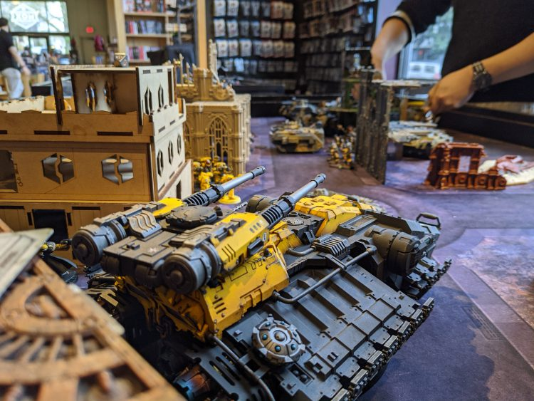 An Imperial Fists Astraeus lines up shots on renegade Leman Russes
