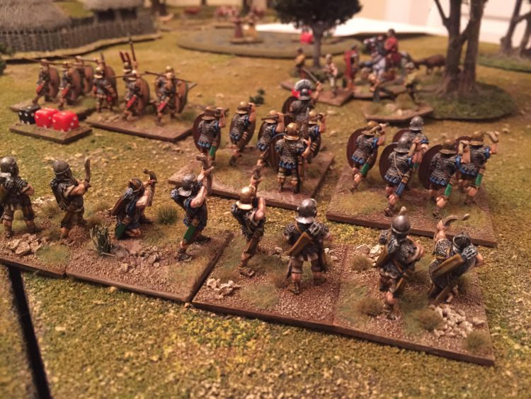 Roman archers shoot over legionaries